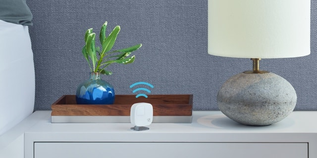 ecobee on a bedside table